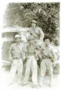Felipe Buencamino III (topmost, leaning on windshield of jeep), photo taken in Bataan, 1942.