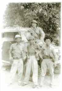 Felipe Buencamino III (topmost, leaning on windshield of jeep), photo taken in Bataan, 1942.